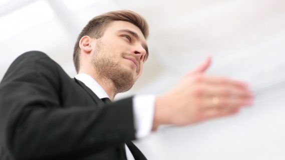 Male lawyer greeting clients
