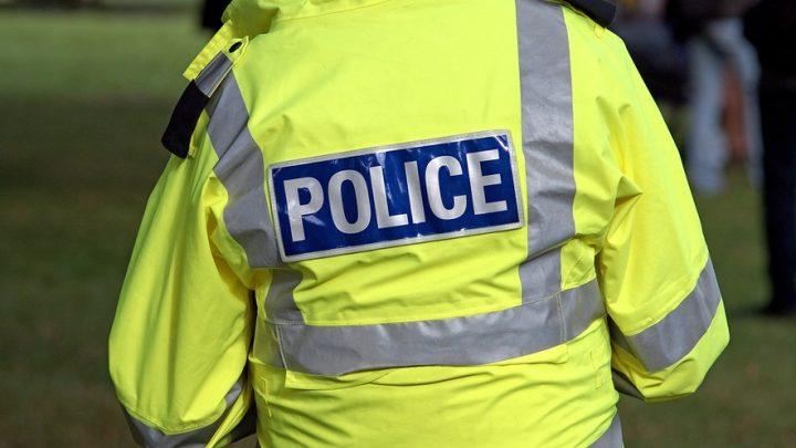 Police wearing yellow jacket