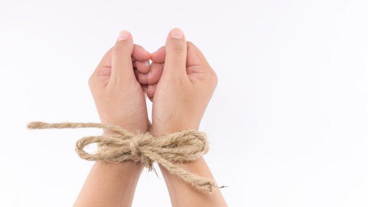 Rope tied wrists