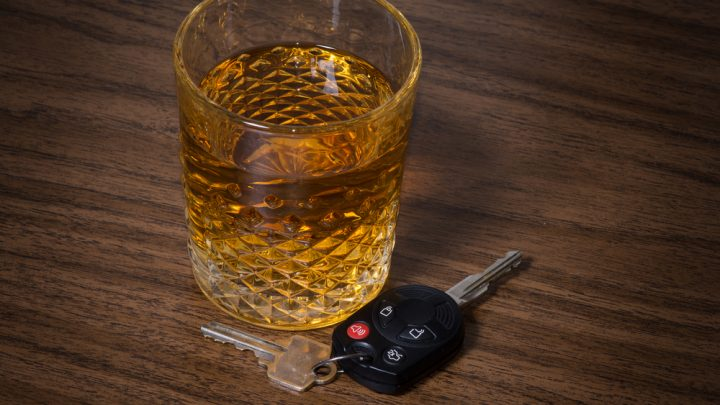 Alcoholic drink beside car keys