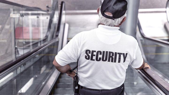 Security guard going down escalator