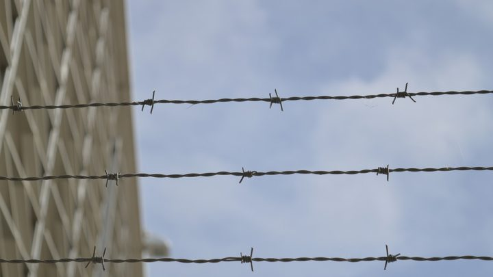 Wire tied on fence