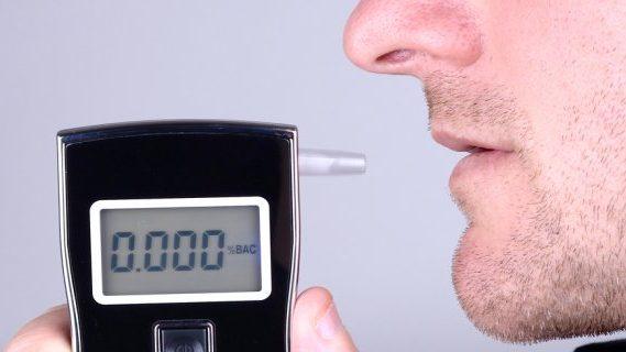 Man using breath tester machine
