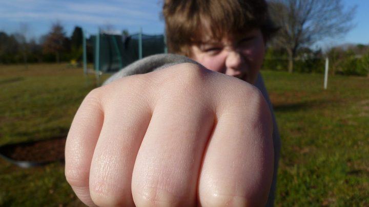 Boy thows punch