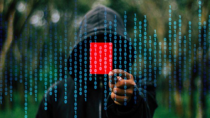 Hoodie man and binary code