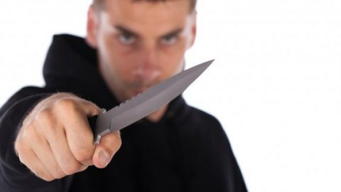 Threatening man with a knife