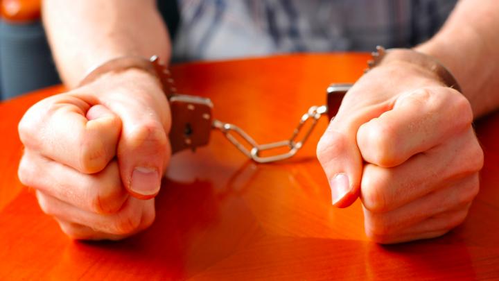 Handcuffed in court
