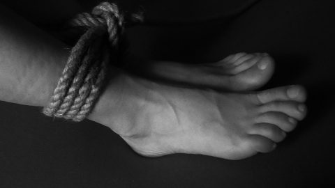 Feet tied with a rope