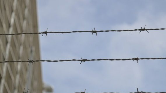Wire on top of fence