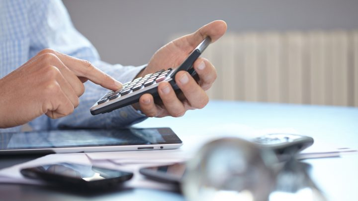 Businessman calculating costs