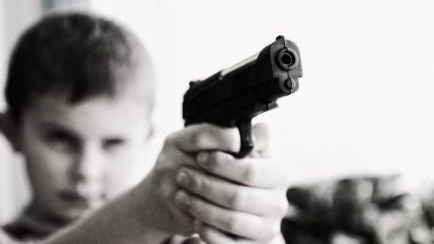 Boy pointing gun