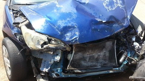 Blue car crushed