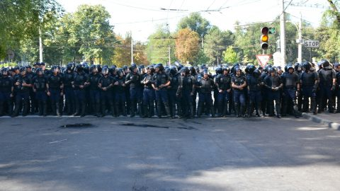 Police officers in a line on a street
