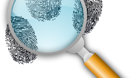 Magnify glass and a fingerprint