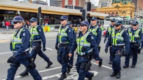 Police in Australia crossing road