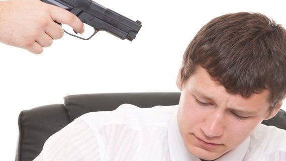 Duress man under pointed gun