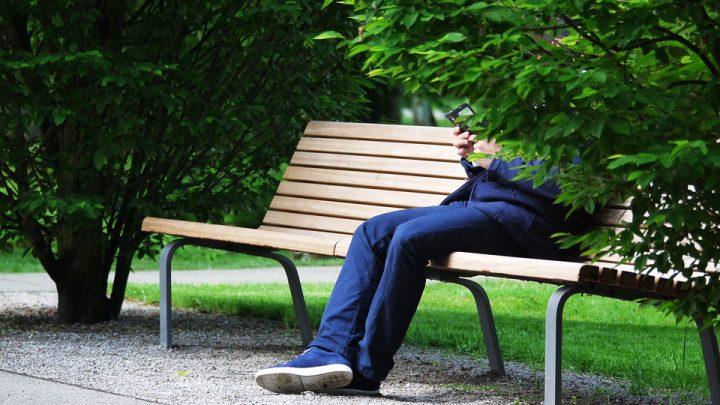 Hidden identity man sitting on bench