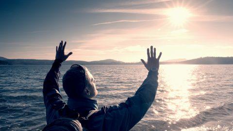 Man free near waterside