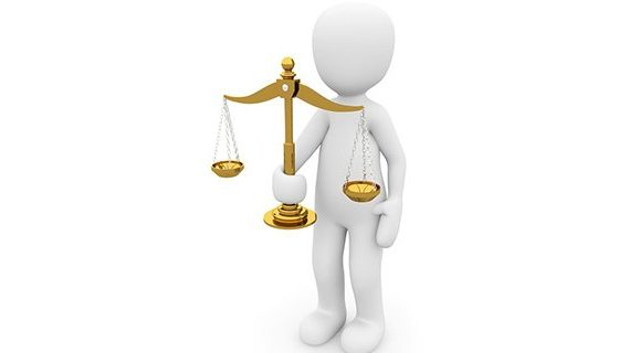 Justice scale held by figure