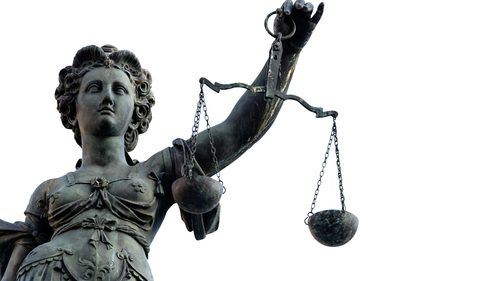 Lady justice and white sky in the background