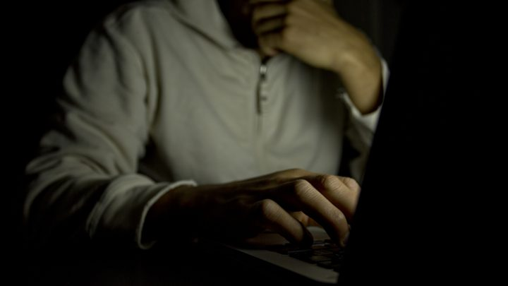 On a laptop in a dark room