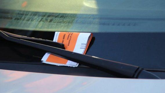 Parking fine on car windshield