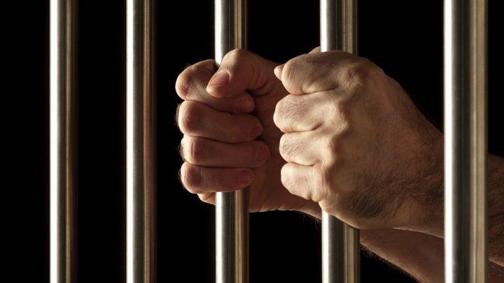 Holding prison bars