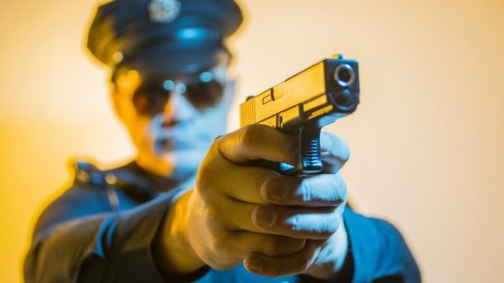 Police officer ready to shoot