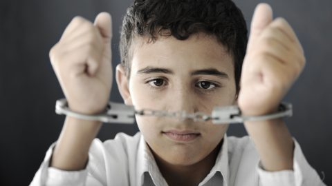 Young boy in handcuffs