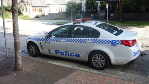 Police car parked on road