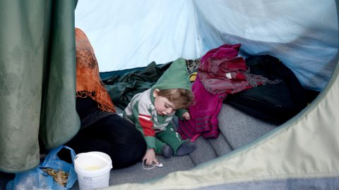 Child within an asylum tent