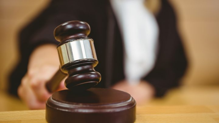 Judge using gavel in court