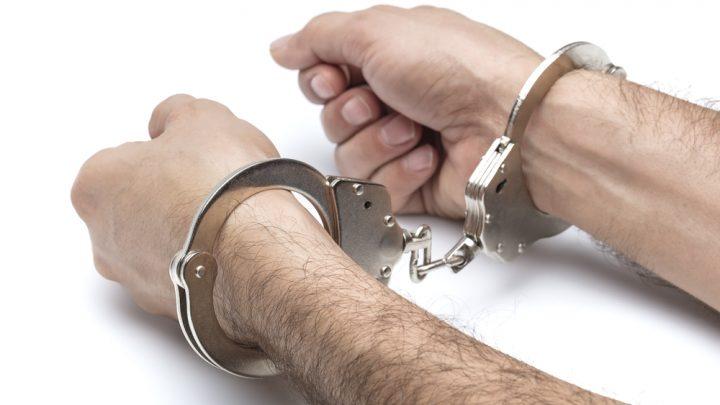 Handcuffs on wrists
