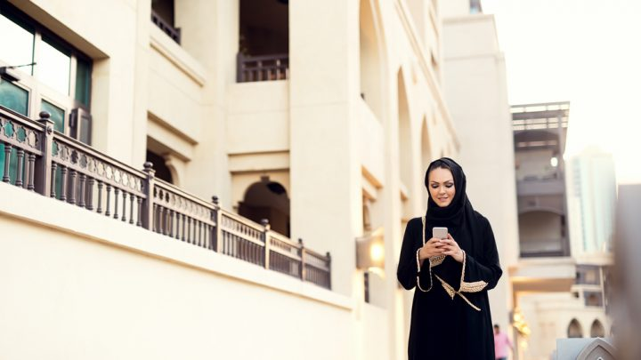Muslim woman on her mobile phone