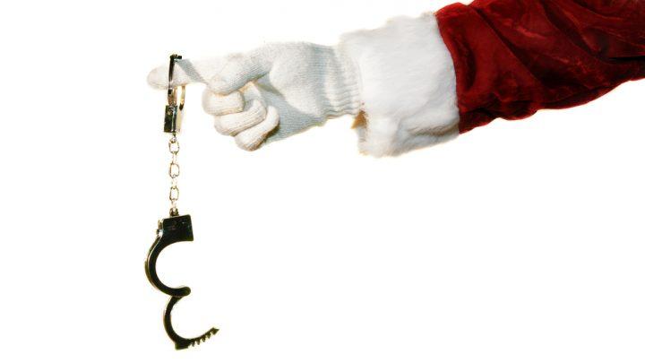 Santa holding handcuffs