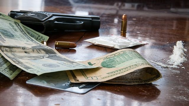 Gun, money, and cocaine on a table