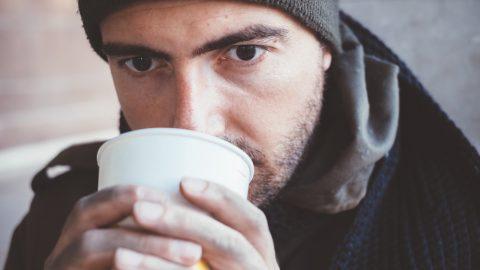 Homeless man drinking