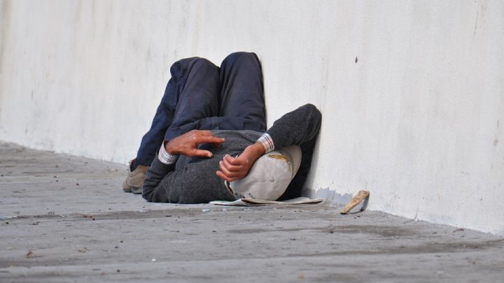 Homeless man laying down