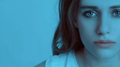 Sad lady in a gloomy blue room