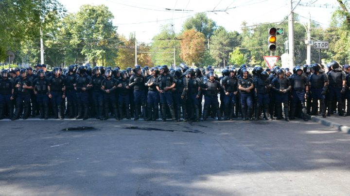 Police officers cover street