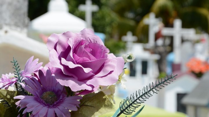 Funeral with purple flowers