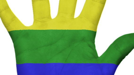 Gay flag painted on a hand