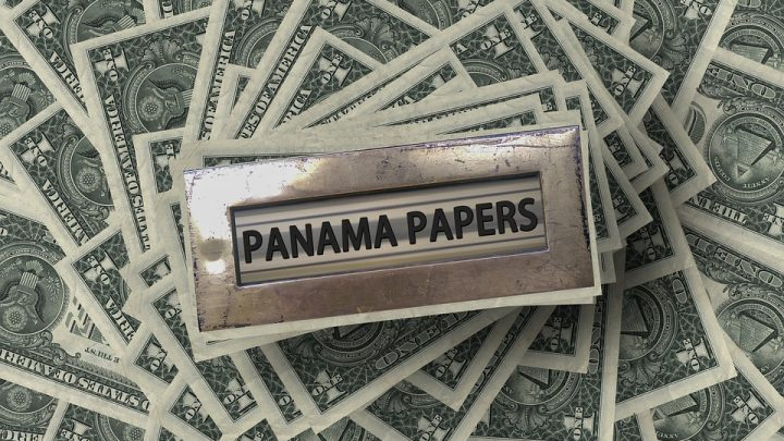 Panama Papers and dollar bills