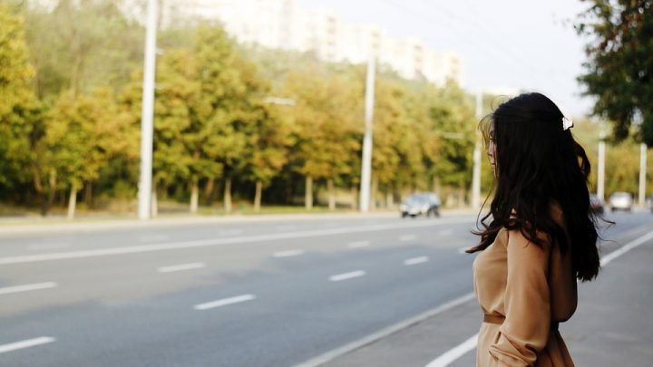 Female waiting by a road
