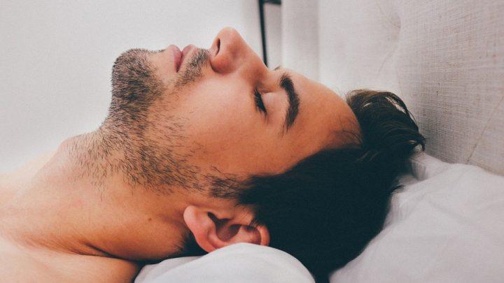 Sleeping man in bed