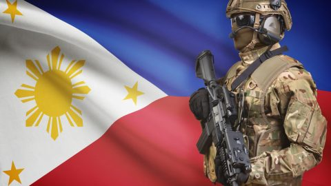 Filipino flag and soldier