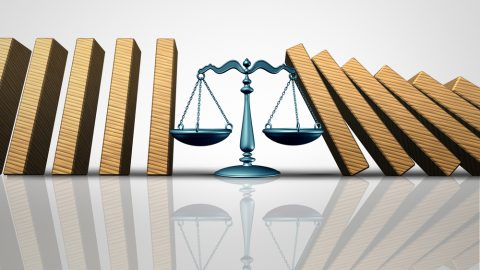 Scale of justice with books