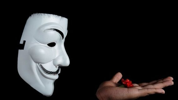 Anonymous holding a red flower