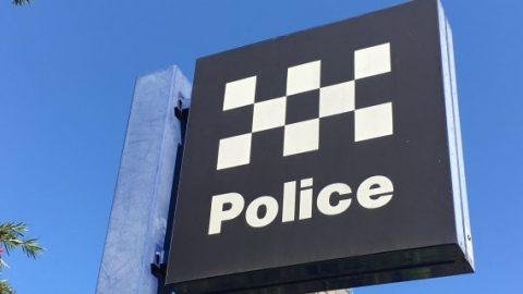 Police sign in daytime
