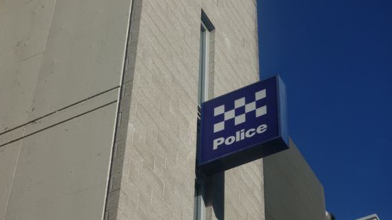 Police station sign on building